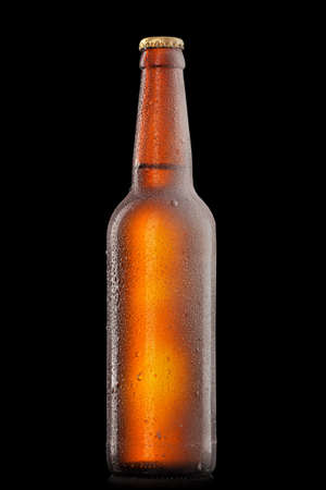 bottle of beer: Beer bottle with water drops and frost isolated on black Stock Photo