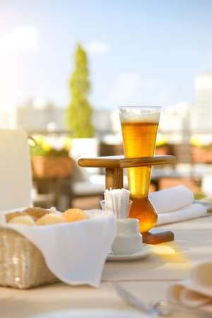 Kwak beer on the served table. Outdoors photo. photo
