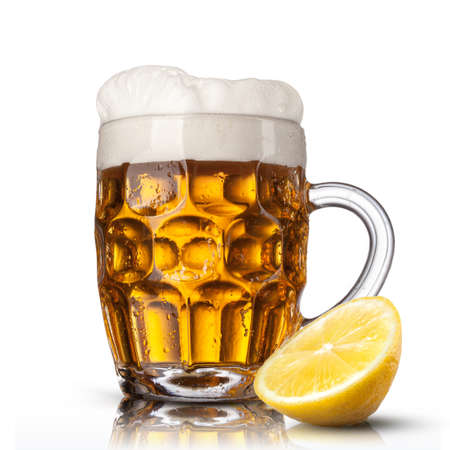 Beer in glass with lemon isolated on white  photo