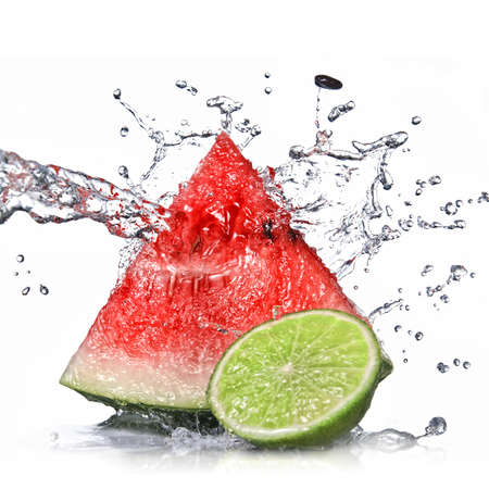watermelon, lime and water splash isolated on white photo