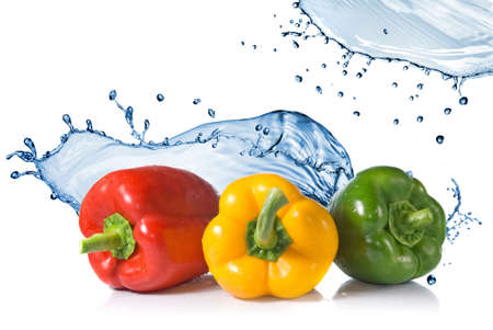 red, yellow, green pepper with water splash isolated on white