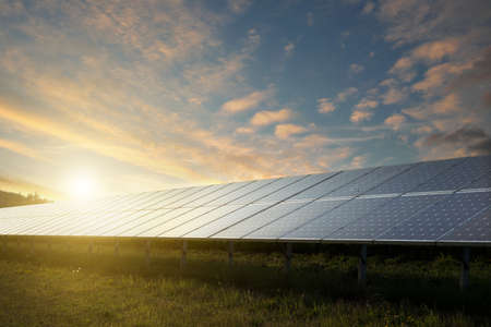 energy generation: solar panels under blue sky on sunset
