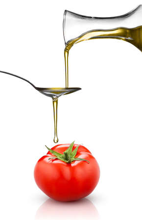 red tomato and pouring oil isolated on white  background photo