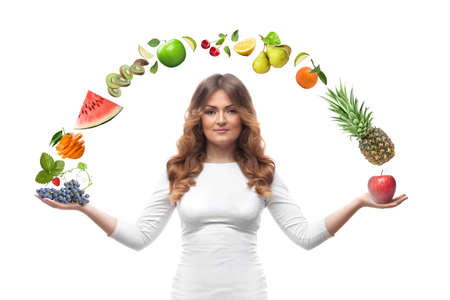 smiling woman with fruits isolated on white photo