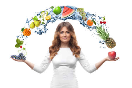 smiling woman with fruits and water splash isolated on white