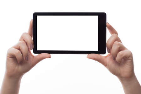 Woman hold tablet PC on white background photo