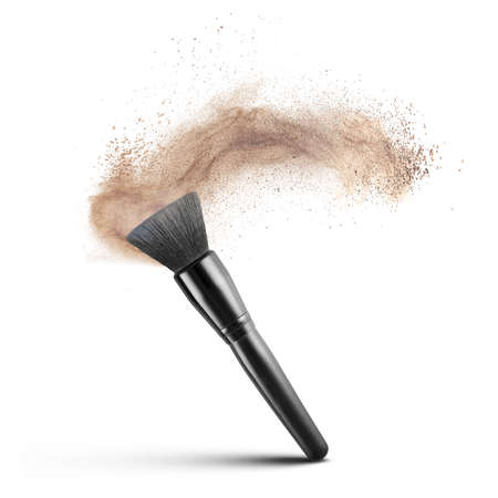 makup brush with powder foundation isolated on white