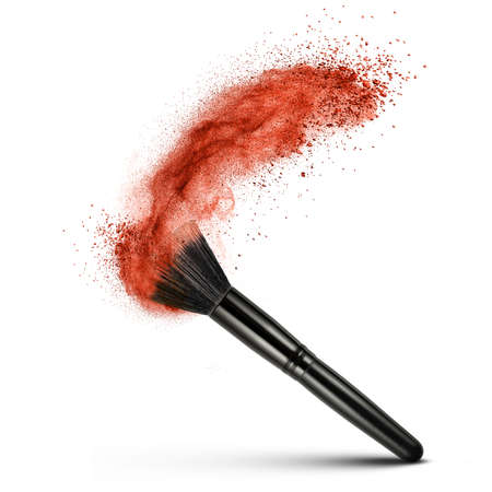 crushed: makeup brush with red powder isolated on white