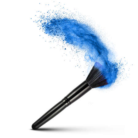 makeup brush with blue powder isolated on white photo