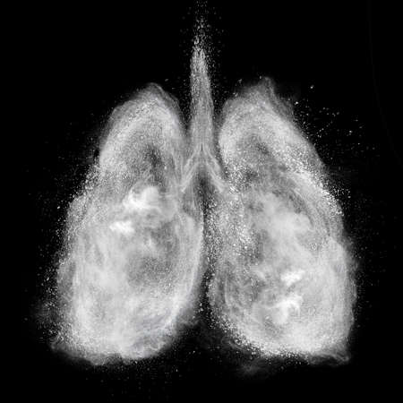 Lungs made of white powder explosion isolated on black background Foto de archivo