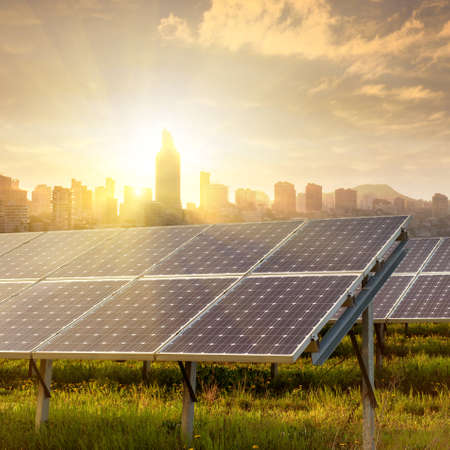 electric power: solar panels under blue sky Stock Photo