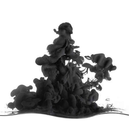 Splash of black ink in dropped into the water isolated on white photo