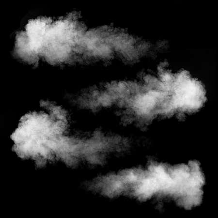 黒の背景に分離した白い煙セット 写真素材