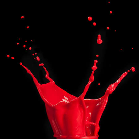 splash of red paint isolated on black background