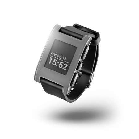 white pebble: Kiev, Ukraine - February 13, 2015: Photo of Pebble smartwatch isolated on white. Product shot