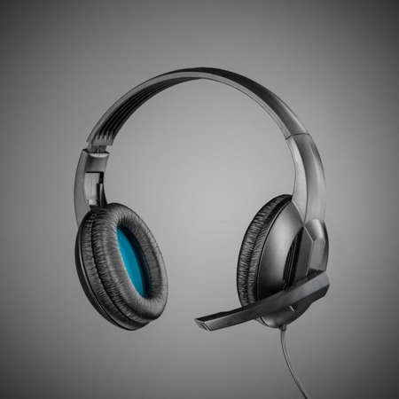 ear phones: Headphones with microphone on grey background