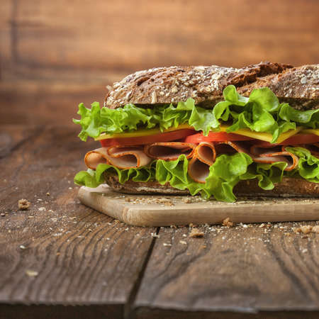 deli sandwich: Sandwich on the wooden table