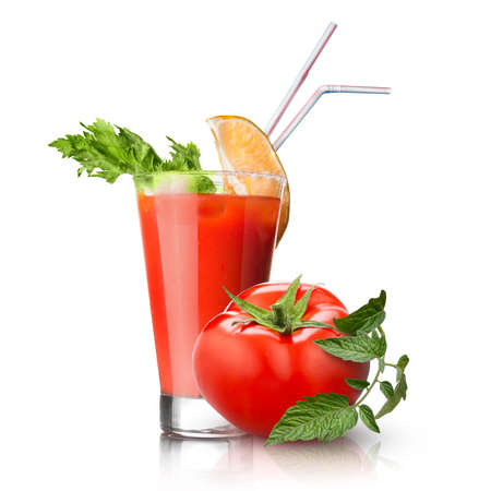 red tomato and glass of juice on white Imagens