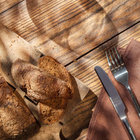 top down: Top view of empty wineglass and bread on served wooden table