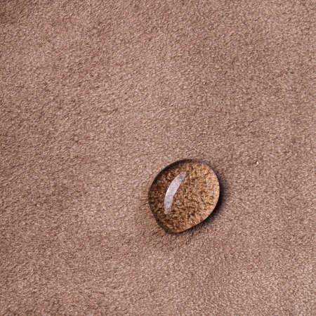 macro photo of water drop on leather Standard-Bild