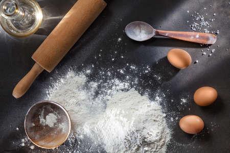 ingridients: flour and ingridients on black table