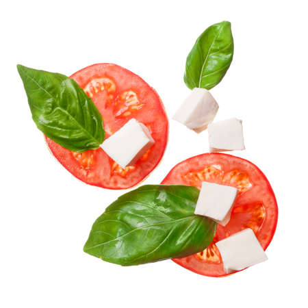 green top: red tomatoes, mozzarella and basil isoalted