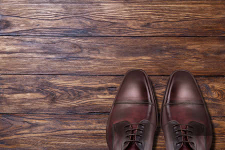 Classic male brown leather shoes on wood 写真素材