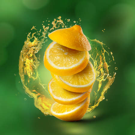 Slices of lemon flying in air with juice splash on green background