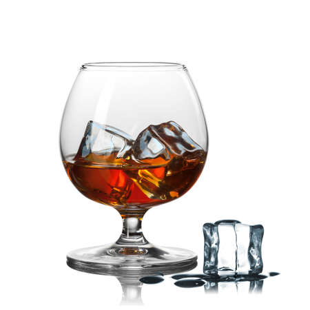 brown white: whiskey with ice in glass isolated on white