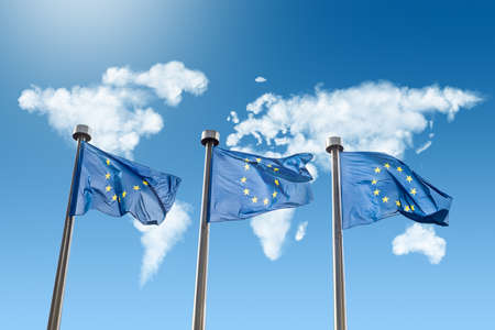 EU flags against world map made of clouds Banque d'images