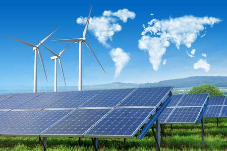 solární panely a větrné turbíny s mapou světa Reklamní fotografie