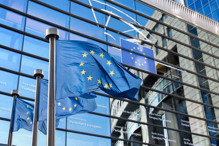European Union flag against European Parliament Imagens