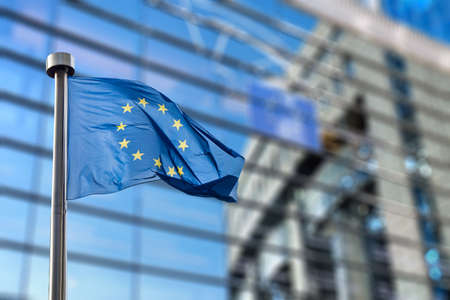 international crisis: European Union flag against European Parliament Stock Photo
