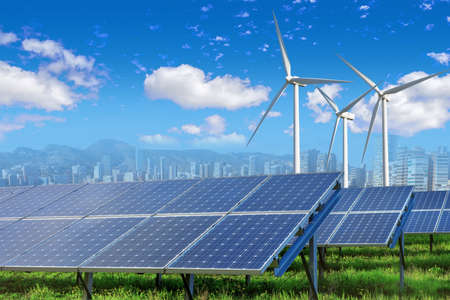 environmental: Solar panels and wind turbines with city