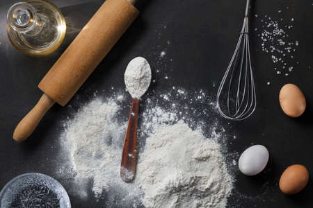salt water: flour and ingredients on black table Stock Photo