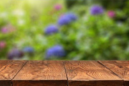 wooden color: wooden empty table and color hydrangea flowers on backgound