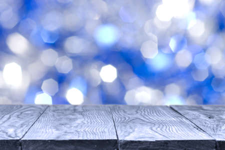 wooden table and blue bokeh abstract natural holidays on background Stock Photo