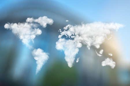 belgique: World map made of clouds against European Parliament in Brussels, Belgium