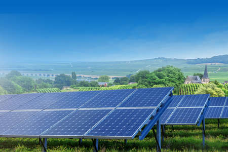 thermal energy: solar panels on summer landscape in France