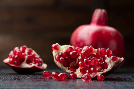 fruit background: pomegranate on the black background
