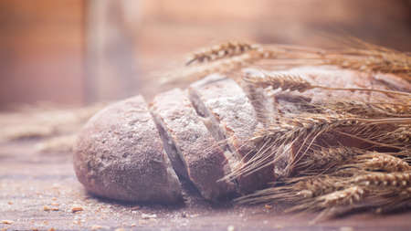 dof: Bread and wheat on wooden table, shallow DOF, raw image
