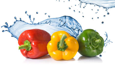 pimenton: red, yellow, green pepper with water splash isolated on white. Header for website