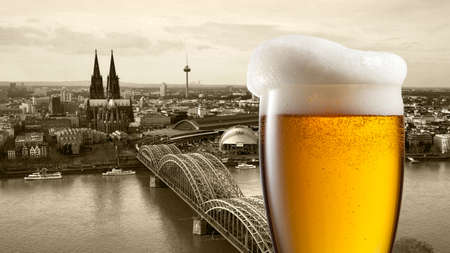 dom: Glass of beer with view of Koeln on background, Germany. Header for website Stock Photo