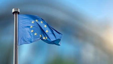 European Union flag in front of the blurred European Parliament in Brussels, Belgium Foto de archivo