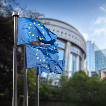 international crisis: European union flag against parliament in Brussels, Belgium