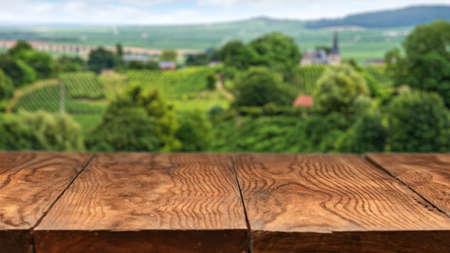 Empty wooden table with vineyard landscape in France on background. Header for website Stockfoto