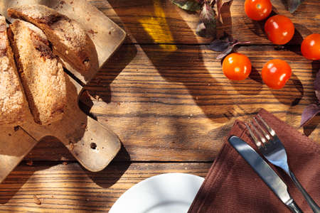 cooking oil: Top view of italian food on wooden table - bread, olive oil and tomatos with basil