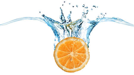 fruit background: Fresh orange dropped into water with splash isolated on white. Header for website Stock Photo