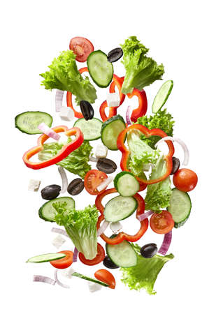 flying salad isolated on white background. 스톡 콘텐츠