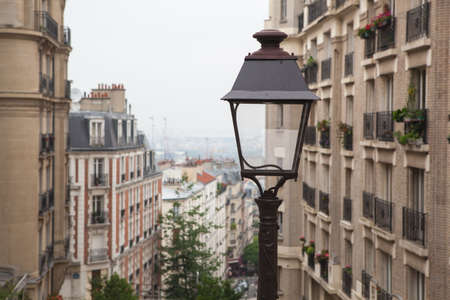 Street light and classic Parisian cityscape, France